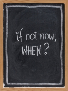 call for action or decision - white chalk handwriting on blackboard with eraser texture